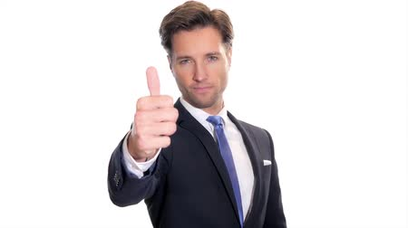 career success : successful businessman showing his thumb up isolated on white