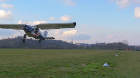krzak : ultra-light aircraft taking off on light cloudy sky