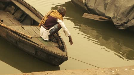 ascetic : Varanasi, India, Ganges River, old man on boat Stock Footage