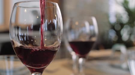 İtalyan : a sommelier serving red wine Stok Video