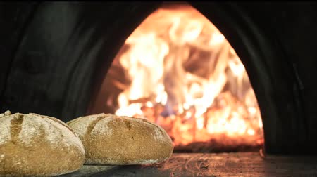 хлеб : baking bread in wood oven Стоковые видеозаписи