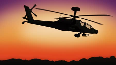 copter : Apache helicopter passing by during sundown Stock Footage
