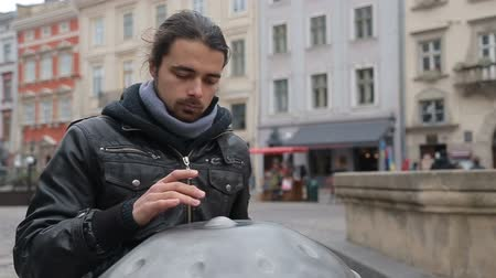 acoustical : Young Street Artist Performing On The Street. Performer With Handpan Or Hang That Is A Traditional Ethnic Drum Musical Instrument Medium Close Up Stock Footage