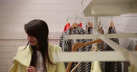 Woman Choosing And Buying Stylish Clothes At Clothing Store Or Apparel Boutique. Female Customers Purchasing Trendy Garments At Shop. Prores Codec