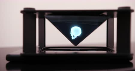 The Smartphone Designs A Hologram Of Skull For A Special Prism That Is On A Hologram Table. Prores 4k