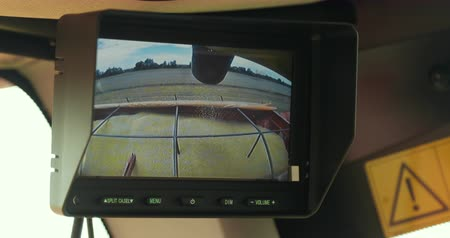 reaping : View Of The Combine Monitor. Harvester Unloading Wheat. Overloading Grain Harvester In Tractor Trailer Tank In The Field. Prores, Slow Motion Stock Footage