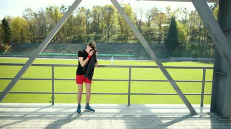čelo : Exhausted Young Man Wiping Sweat With Towel From His Forehead After Exercising. Tired Sportswoman Drinking Water And Resting Near Stadium. Concept Sorowako Lifestyle And Sports. Prores, Slow Motion 4k Dostupné videozáznamy
