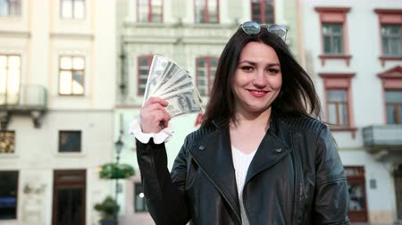 won : Young beautiful girl in black glasses won a lottery money and rejoice in wealth. The concept of a happy and rich life. Prores, Slow Motion, 4k Stock Footage