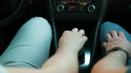 csatlakozott : Two guys holding hands in car. Gay puts his hand on gearbox, his lover touches palm to skin, strokes gently and puts it on top as sign of love homosexuals. Close-up, slow motion, prores