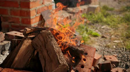 çok güzel : bright burning wood, around pieces of brick, very good flame, orange, Sunny weather day, slow shooting, close-up