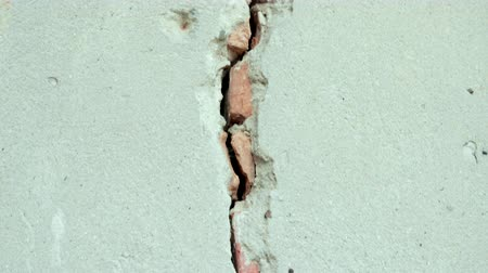 abandonar : stripped the old grey wall plaster with holes, cracks, old castle