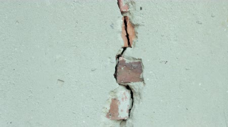 roto : stripped the old grey wall plaster with holes, cracks, old castle