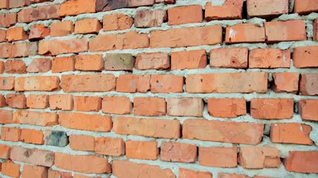 front cover : red brick and stone wall with damaged old brick, background for design