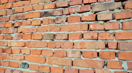 rachado : red brick and stone wall with damaged old brick, background for design