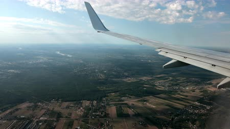 böjti réce : Airplane flight. View through the window of an airplane of the wing and turbine.