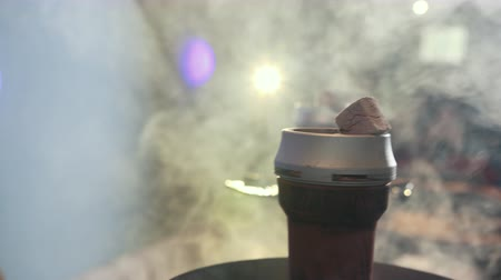 tobacco : hookah bar. close up process of making hookah for smoking. concept of smoking hookah and having good time. hookah bowl and coal, lots of thick smoke, slow motion Stock Footage
