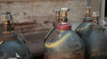 калибр : on street near old buildings, plant, are worth many gas cylinders, slow motion, close up