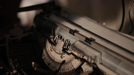 platen : close-up of process of ancient printing machine, man in white gloves presses keyboard, slow motion