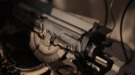 maquina de escribir : close-up of process of ancient printing machine, man in white gloves presses keyboard, slow motion