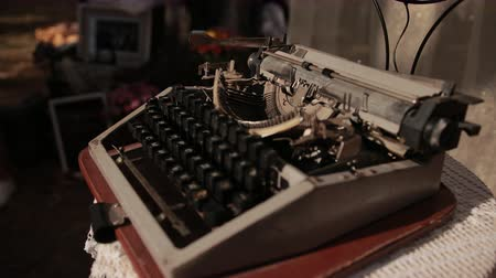 lever : an old typewriter, which stands on table with white knitted tablecloth, close-up, slow motion Stock Footage