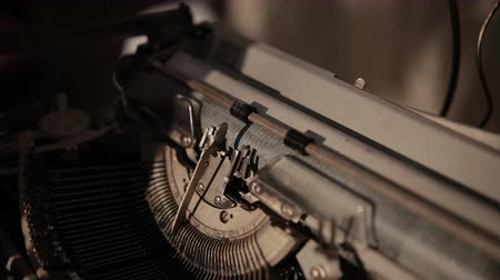 lever : close-up of process of ancient printing machine, man in white gloves presses keyboard, slow motion
