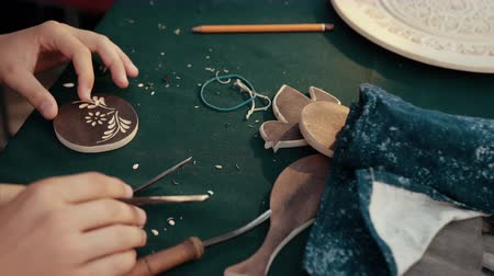 yöntem : Amazing wood craft rapid slow motion. Close-up hands of master are making carpentry work on pieces of wood with ethno ornaments. Stok Video