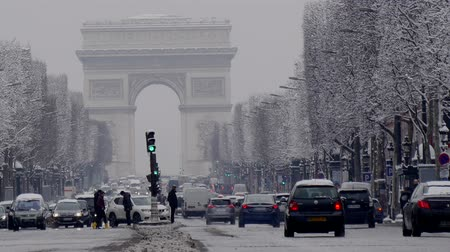 triumphal arch : The arc de triumph by a rare snowy day in Paris, France
