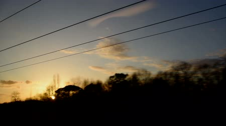 The view from the train window overlooking the sunset.