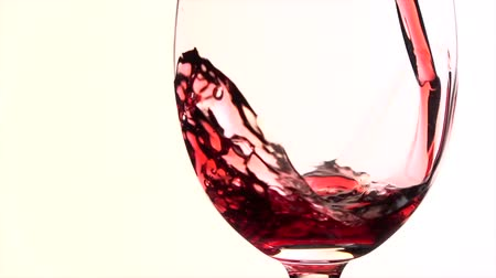 каберне : Red wine poured into glass on white background