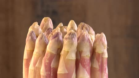feixes : Portion of fresh white Asparagus on turn table Stock Footage
