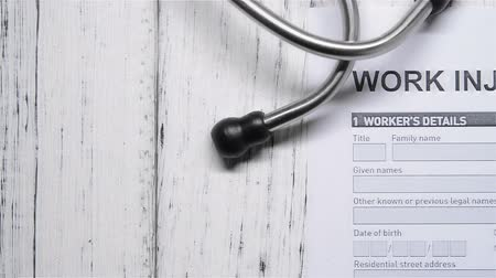compensar : work injury claim form with stethoscope