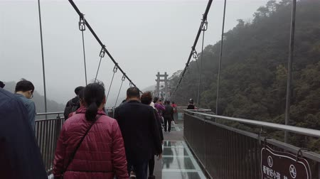 süspansiyon : QingYuan GuangDong China-Feb 16,2019:people walking on a glass bridge