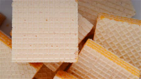 migalhas : top view cheese wafer blocks rotating Stock Footage