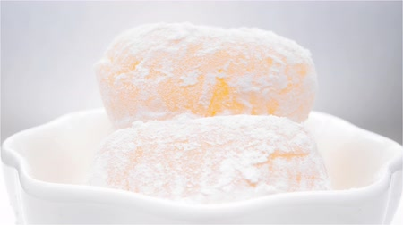 rice cake : mochi or glutinous rice dumplings rotating