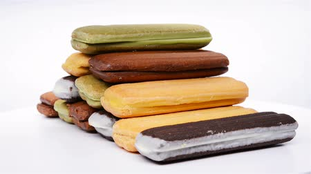 chunky : side view multicolor sandwich cookies, rotate and pause on white background