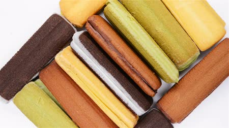 chunky : top view multicolor sandwich cookies, rotate and pause on white background