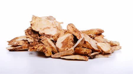 common : side view Chinese herb medicine of Anemarrhenae Rhizoma or Common Anemarrhena rotate and pause