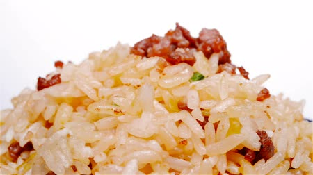 pauza : fried rice with beef on a bowl rotate and pause close up