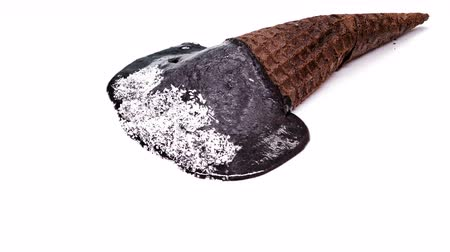 aprított : side view chocolate flavor ice cream cone with shredded coconut melting on white background time lapse