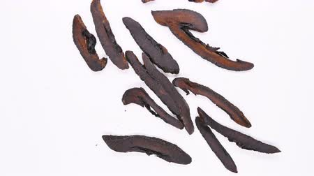 amargo : top view herb medicine ZhiQiao or Aurantii Fructus or Submature Bitter Orange rotate and pause