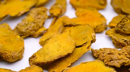 antioxidant : side view herb medicine JiangHuang or Curcumae Longae Rhizoma or Common Turmeric Rhizome rotate and pause