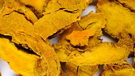 top view herb medicine JiangHuang or Curcumae Longae Rhizoma or Common Turmeric Rhizome rotate and pause