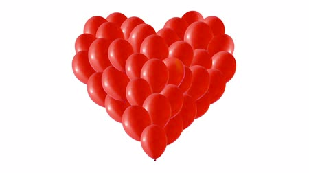 fitas : Red balloons in the shape of a heart. Congratulation to the holiday. Background with colorful balls. Vídeos