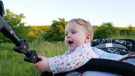 unicef : Little Girl is happy and smiles in the stroller 4k video