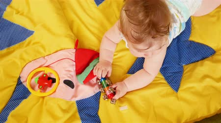 kiddy : Seven month old baby Playing on colored carpet. Stock Footage