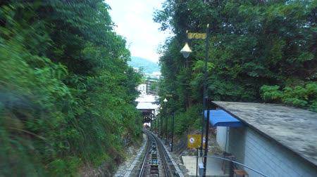 Ride on cable car road on Penang hill, Georgetown, Malaysia. View from inside.