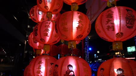 Glowing Red Chinese lanterns at night, slow motion