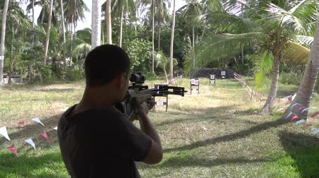 Caucasian man shooting with crossbow at archery Vídeos