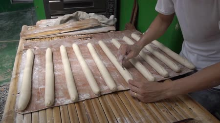 bagietka : Preparing dough for baking baguette at bakery Wideo