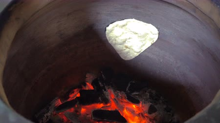 charcoal stove : Baking garlic naan. Indian cuisine Stock Footage